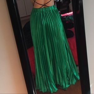 Green pleated satin maxi skirt